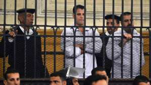Egyptian policemen Awad Suleiman (C-R) and Mahmoud Salah (C-L) in the dock during their retrial for the manslaughter and torture of Khaled Said, Alexandria on March 3, 2014. (AP Photo/Amira Mortada, El Shorouk Newspaper)